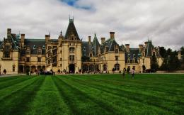 "Biltmore House, the main house on the estate, is a Châteauesque-styled mansion built by George Washington Vanderbilt II between 1889 and 1895 and is the largest privately owned house in the United States, at 178,926 square feet. In the 1880s, at the height of the Gilded Age, George Washington Vanderbilt, youngest son of William Henry Vanderbilt, began to make regular visits with his mother, Maria Louisa Kissam Vanderbilt (1821–1896), to the Asheville, North Carolina, area. He loved the scenery and climate so much that he decided to create his own summer estate in the area, which he called his ""little mountain escape,"" just as his older brothers and sisters had built opulent summer houses in places such as Newport, Rhode Island, and Hyde Park, New York."